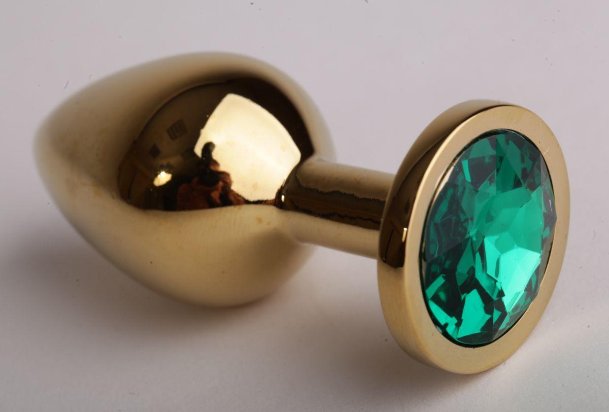Золотистая анальная пробка с зеленым кристаллом - 9,5 см. фото