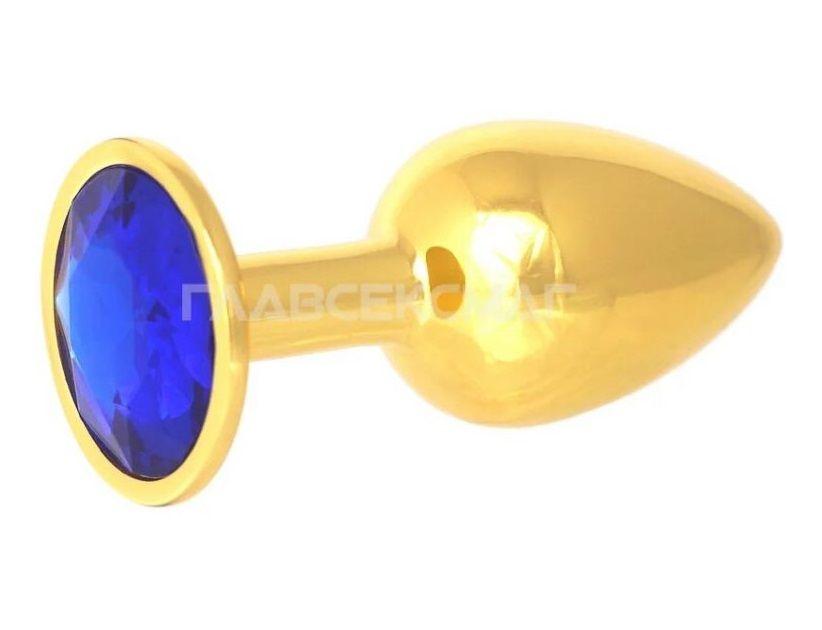 Золотистая анальная пробка с синим кристаллом - 7 см..